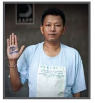 Bo Gyi, co-founder and joint secretary of the Assistance Association for Political Prisoners, seen here in the 2010  'Even though I am free  I am not' campaign (Photo: AAPP)