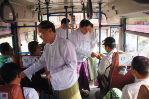 Rangoon Chief Minister Myint Swe leads a campaign to promote the new SRT-1 bus route. (PHOTO: MoI)