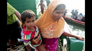 Young mother with child abroad a vessel carrying refugees in Andaman Sea. (Reuters screenshot)