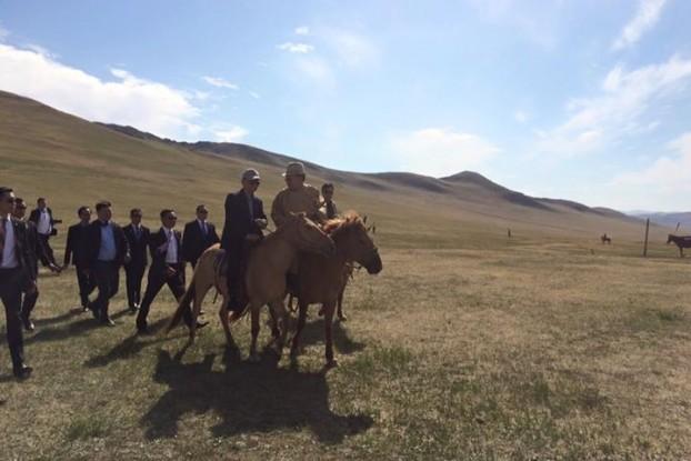 Burmese President Thein Sein and Mongolian President President Taskhiagiin Elbegdorj take a horse ride together. (PHOTO: Ye Htut).