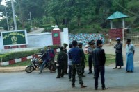Prison guards stand at a checkpoint outside a military base close to the prison. (PHOTO: DVB).