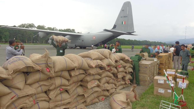 Flood aid begins arriving from India, China
