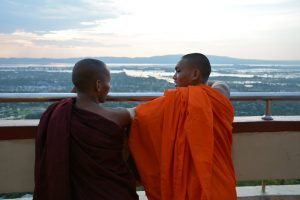 Young monks enjoy the view from Mandalay Hill. (Colin Hinshelwood/ DVB)