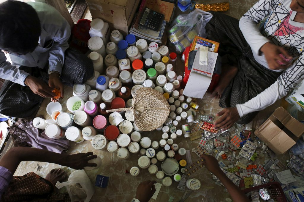 Traditional and western medicines mixed up at a makeshift clinic at the Thae Chaung camp for internally displaced people in Sittwe, Arakan State PHOTO: Reuters