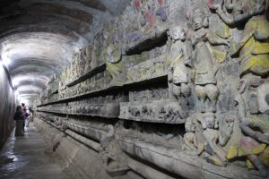Intricate carvings of Buddhist scenes are seen in the hallways of the Sitthaung Temple in Mrauk-U. (Photo: Thin Lei Win / Myanmar Now)