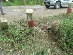 The remains of thin red wirs were reportedly found at the scene of the explosion, running from the road down to this ditch. (PHOTO: La Raw Raw)