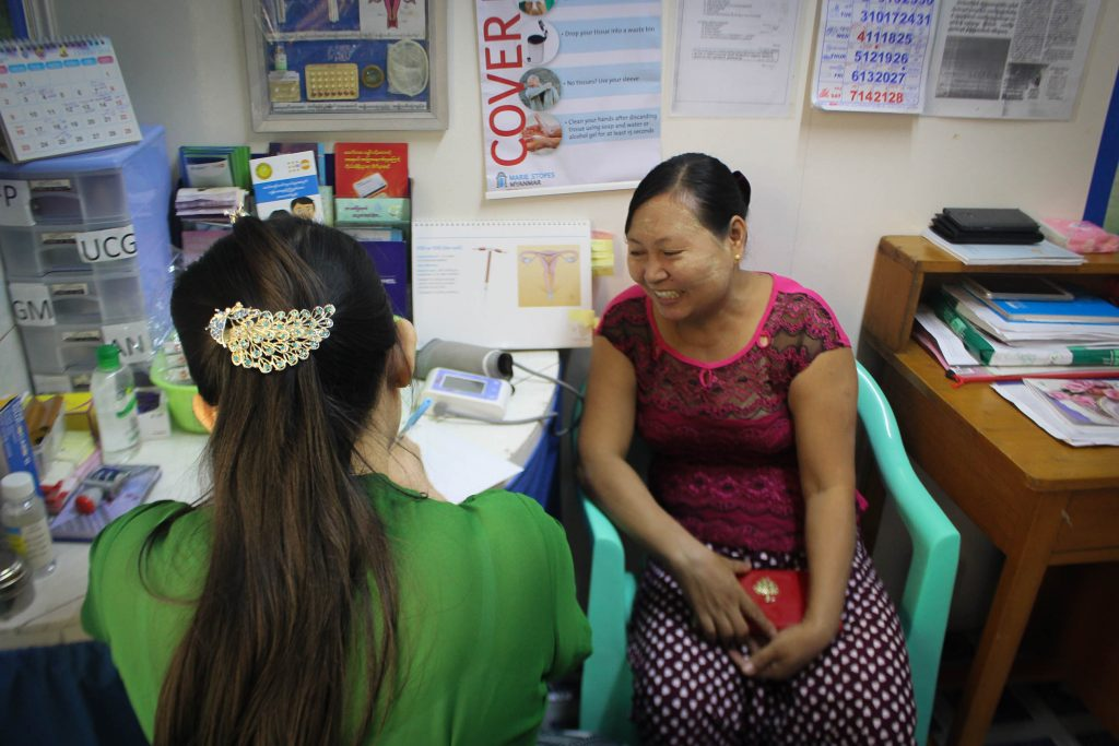 A lady discusses contraceptives with her doctor in a clinic on the outskirts of Rangoon. (Photo: Libby Hogan / DVB)
