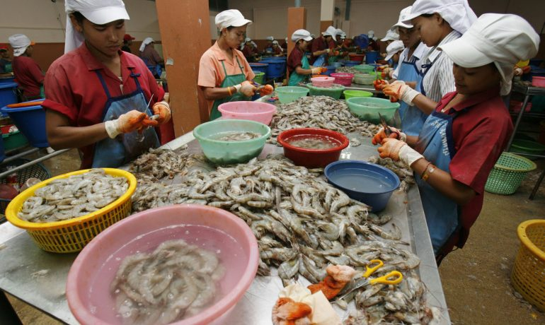 Burmese lead migrants' push for better pay, benefits at Thai seafood firm