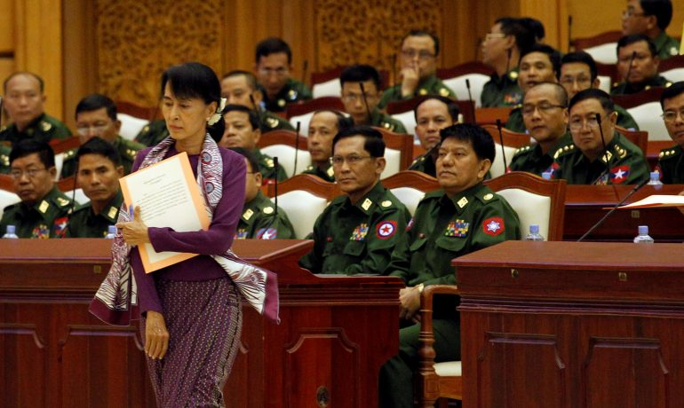 In speech marking a year in office, Suu Kyi admits reforms have been slow
