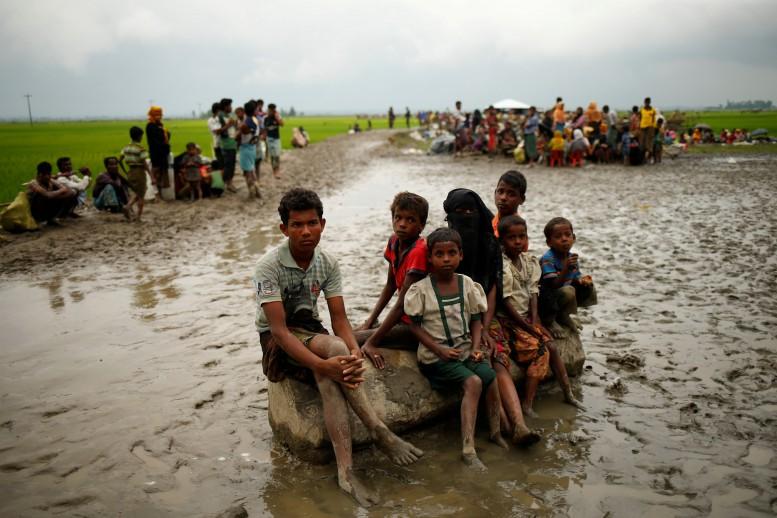 Suu Kyi under pressure as Rohingya exodus passes 123,000