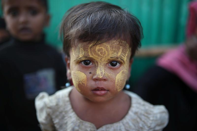 Hiding from traffickers in 'prison-like' tents, Rohingya girls dream of school