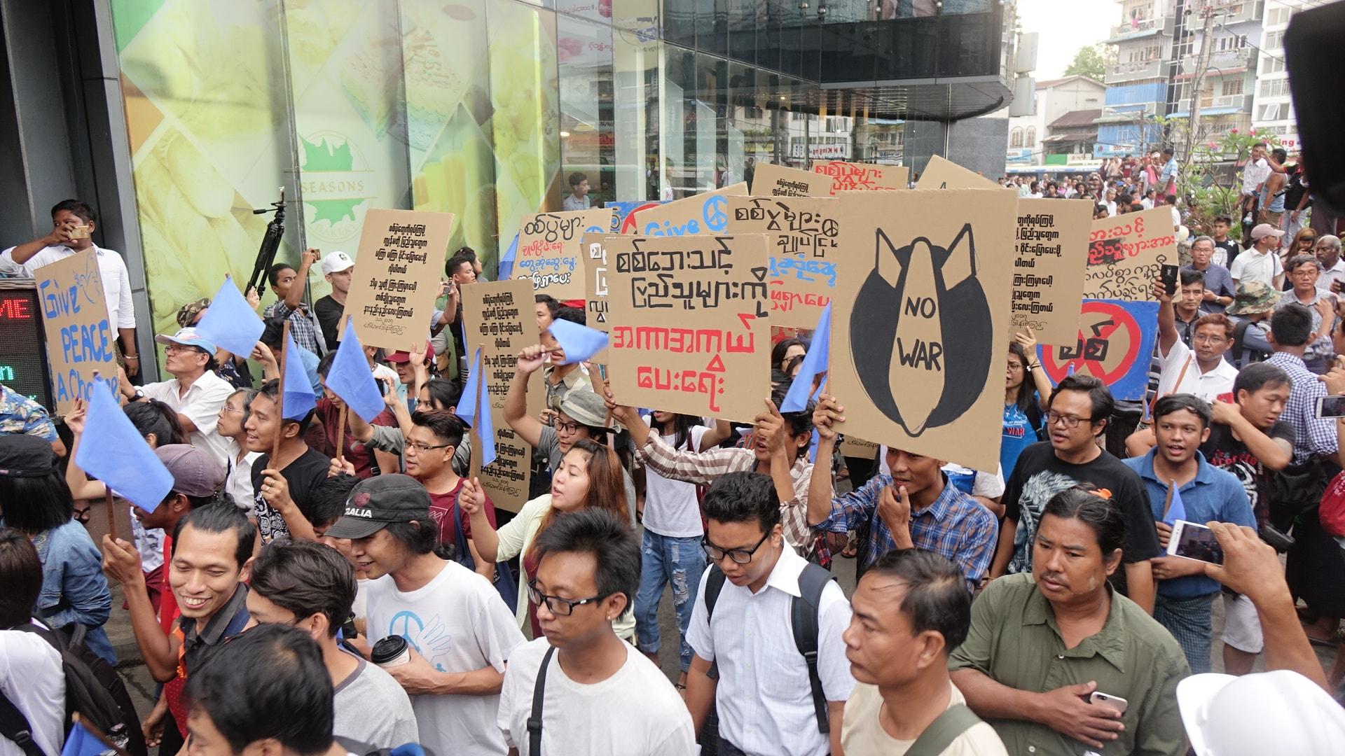 Riot police break up anti-war protest in Yangon