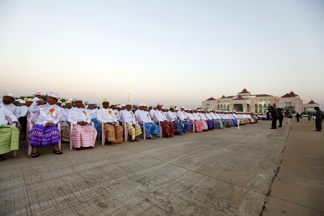 Members of parliament attend a ceremony to mark the 64th Myanmar Union Day in front of the City Hall in the new capital Naypyitaw