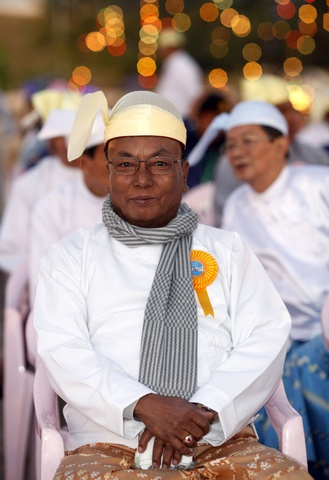 Khim Aung Myint, the chairman of the Upper House of Myanmar's parliament, attends a ceremony to mark the 64th Union Day in front of the City Hall in the new capital Naypyitaw