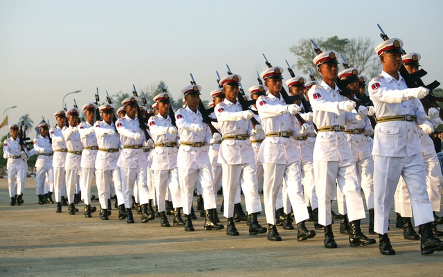 Soldiers march with their rifles during a ceremony to mark the 64th Myanmar Union Day in front of the City Hall in the new capital Naypyitaw