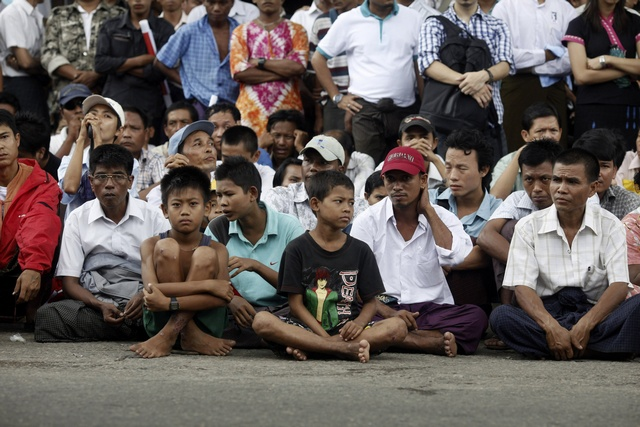 People wait to pay tribute during an event marking the anniversary of Martyrs' Day in Yangon