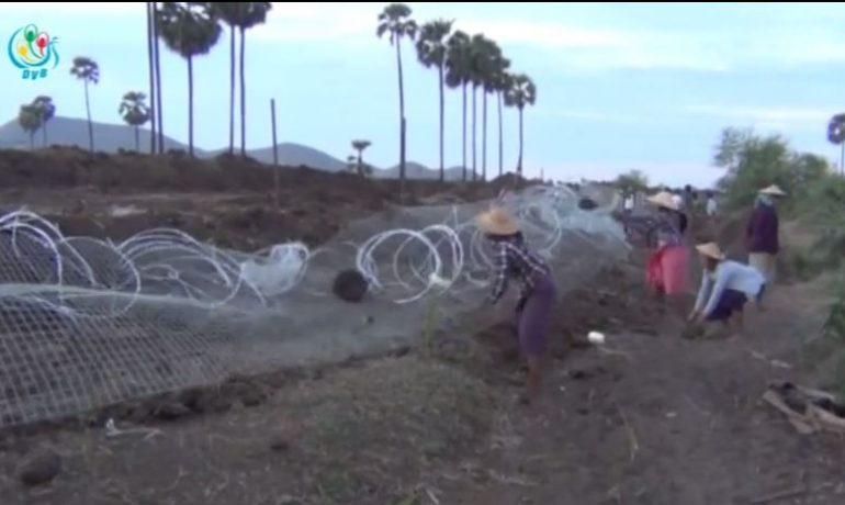 Latpadaung villagers tear down Wanbao fence