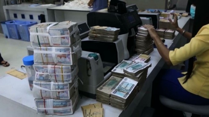 The US dollar is predicted to strengthen further against the kyat. (PHOTO: DVB).