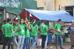 Locals decked out in USDP t-shirts support the rally in Myaungmya Township. (PHOTO: DVB)