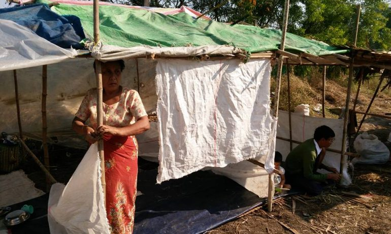 Squatter eviction highlights Suu Kyi's military challenge