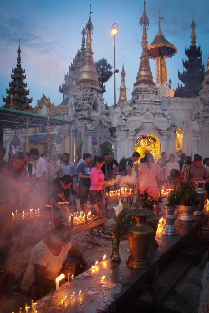 Colourful lanterns and flower decorations inside Shwedagon Pagoda. (Photo: Libby Hogan / DVB)