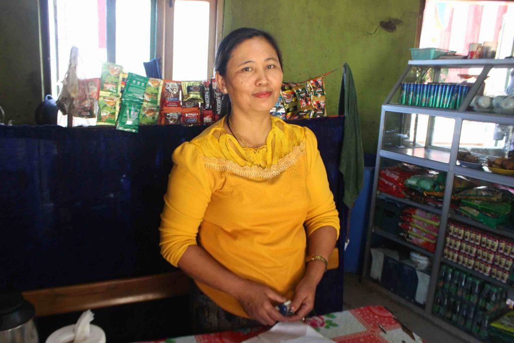 Par Nei Cuai is part of the women's savings group who took a loan to start her own teashop business. (Photo: Libby Hogan/DVB)