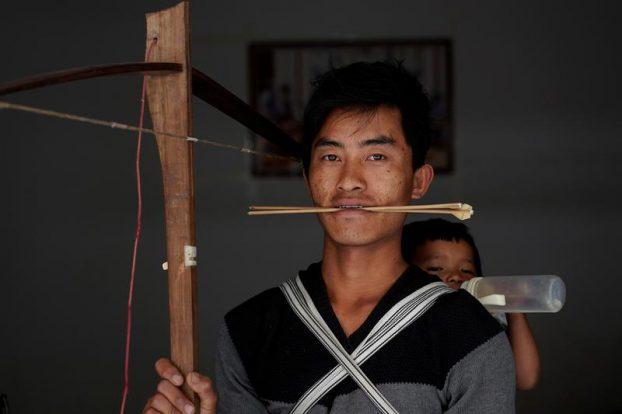 The Wider Image: China's Lisu aim to save crossbow culture