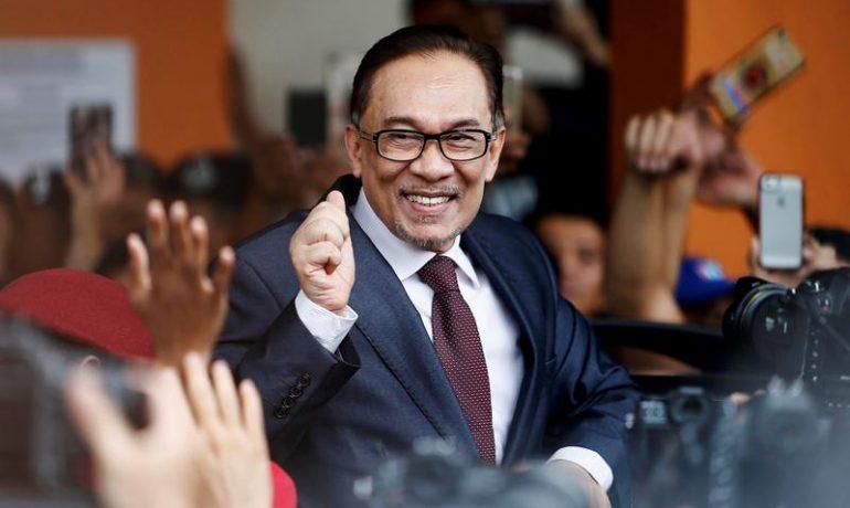 Jailed Malaysian leader Anwar Ibrahim walks free after royal pardon